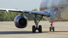 Wizz air airplane roll on runway, medium shot Stock Footage