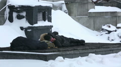 Homeless sleeping on the grate of the ventilation wells in the winter in Russia. Stock Footage