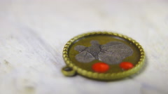 Applying red paint on bronze pendant closeup 4K Stock Footage