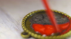Red and grey paint inside a pendant macro shot 4K Stock Footage