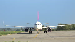 Wizz air airplane roll over runway Stock Footage