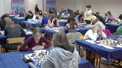 Many young women are playing chess. - stock footage