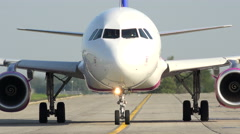 Wizz air airplane roll over runway, front view Stock Footage