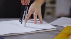 Drawing circles with compass on paper 4K Stock Footage