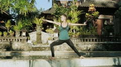 Young woman doing yoga outside in natural environment Stock Footage
