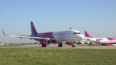 Wizz air airplane roll on runway Stock Footage