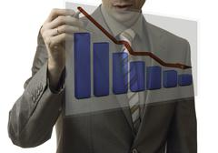 business concept. businessman drawing a graph down - stock photo