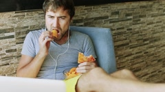Man working at the computer and eating fast food. Unhealthy Lifestyle. - stock footage
