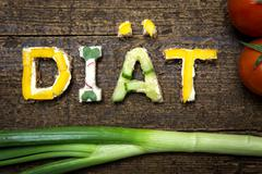 Letters of vegetable canapes build the word diät Stock Photos