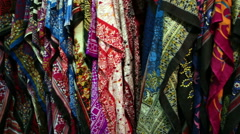 Lot of colorful scarves hanging on the rack. Stock Footage