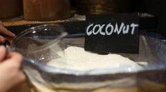 Buying coconut powder in spices market Stock Footage