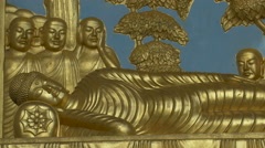 Buddha with followers sculptures in London Stock Footage