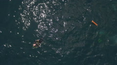 Aerial shot of scuba diver with safety buoy on the sea surface Stock Footage