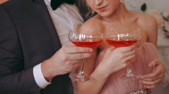 Newlyweds pose for the camera while holding the glasses in hand Stock Footage