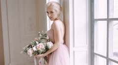 Stock Video Footage of Beautiful, delicate and feminine bride. Wedding bouquet of roses.