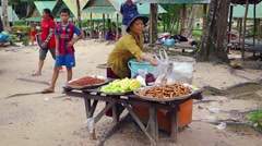 Local vendor selling traditional snacks at Phnom Kulen. Video UltraHD Stock Footage