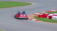 Red go cart takes an s curve at high speed at Phuket Kart in Kathu town Stock Footage