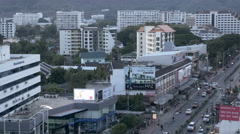 Establishing shot of a street and apartment complexes in Chiang Mai, Thailand Stock Footage