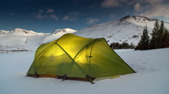 Tent illuminated in snow time lapse Stock Footage