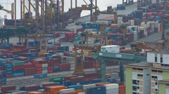 Typical operations at Singapore's enormous shipping port. Video 3840x2160 Stock Footage