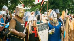 Historical restoration of knightly fights. The siege of wooden f - stock photo