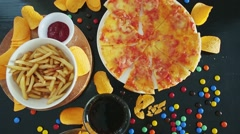 Fast food and unhealthy eating concept - close up of pizza - stock footage