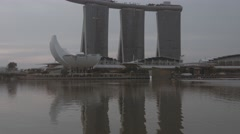 Vericcal panning on Marina Bay Sands and ArtScience Museum buildings Stock Footage