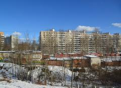 Stock Photo of Solnechnogorsk, Russia - February 27. 2016. high-rise buildings and metal gar
