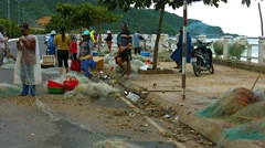 Locals preparing equipment for a fishing expedition. Video 3840x2160 Stock Footage