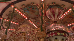 Low angle of a spinning carousel at the Christmas market in Nuremberg Stock Footage