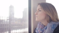 Young woman on a train drinks her hot drink on a train, in slow motion Stock Footage