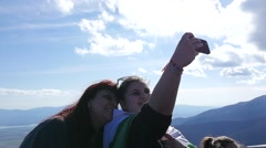 Female taking selfie picture in nature mountains picturesque view Stock Footage