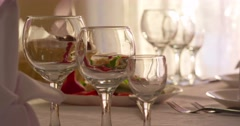 Glasses of wine in sun light in on Exquisite banquet Stock Footage