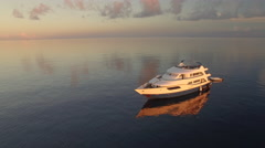 aerial shot of luxury yacht in sunset - Maldives Island - stock footage