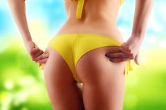 Sexy female buttocks. Weight loss - stock photo