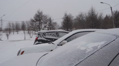 Snow-covered cars in the city Stock Footage