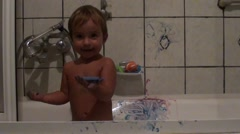 Child in bath dirty with finger paint 2 Stock Footage