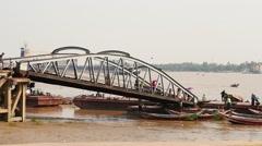Piers and bridge with people hyperlapse view in Yangon of Myanmar Stock Footage