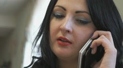 Business lady talks on the phone in cafe Stock Footage