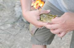 Fisherman Removing Hook Closeup - stock photo