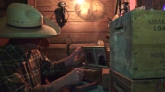 Cowboy in the bunkhouse , searching family history Stock Footage