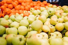 Apples and oranges on the market Stock Photos