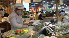 Preparing fresh Vietnamese spring rolls in modern supermarket Saigon Stock Footage