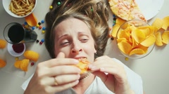 Unhealthy concept. Woman with unhealthy food Stock Footage