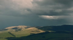 Dramatic light makes it ways across the Tweed Valley, Scottish Borders Stock Footage