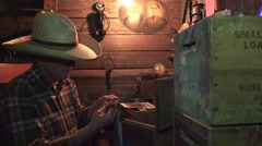 Cowboy in the bunkhouse , large skeleton key from box Stock Footage