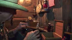 Cowboy in the bunkhouse , old currency $5 bill Stock Footage