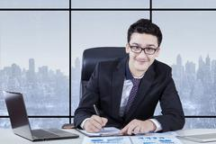 Arabian businessman with formal suit in office Stock Photos