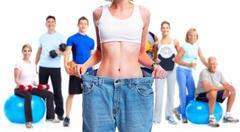 Slimming woman wearing big pants. Stock Photos