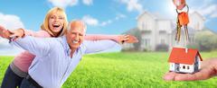 Happy senior couple near family house. Stock Photos
